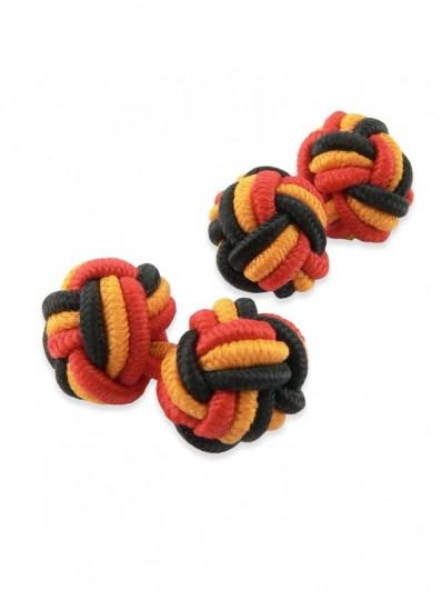 Knot 610 - Bouton de manchette en Passementerie rouge, noire et orangée.