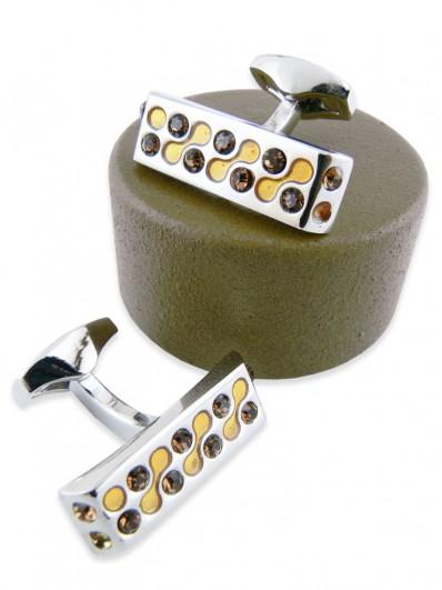 Bouton de manchette en rhodium, émail et cristal Swarovski ambré.