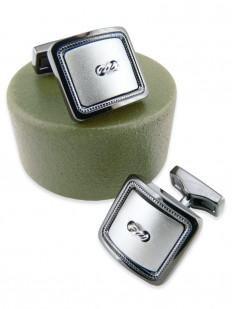 Bouton de manchette carré en métal bicolore bronze et rhodium.