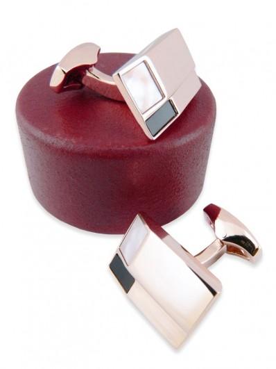 Bouton de manchette en nacre et onyx sur monture or rose.