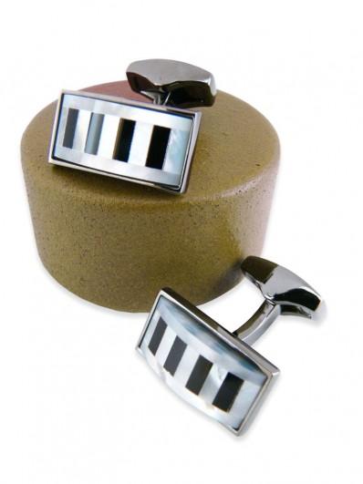 Bouton de manchette en touches de piano sur monture bronze.